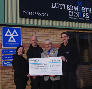 Presenting Lutterworth Mayor with cheque for charity